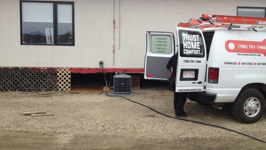 Installing an A/C for the showroom of LUX Condo